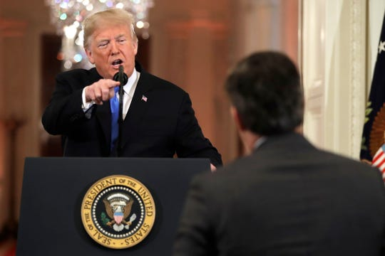 President Donald Trump points to CNN's Jim Acosta as he speaks during a news conference in the East Room of the White House, Wednesday, Nov. 7, 2018, in Washington. (AP Photo/Evan Vucci) ORG XMIT: DCEV411