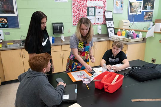 When teaching art at Moorestown, New Jersey's William Allen Middle School, art teacher Julia Mooney often covers her One Outfit, 100 Days project dress with an apron to keep it clean.