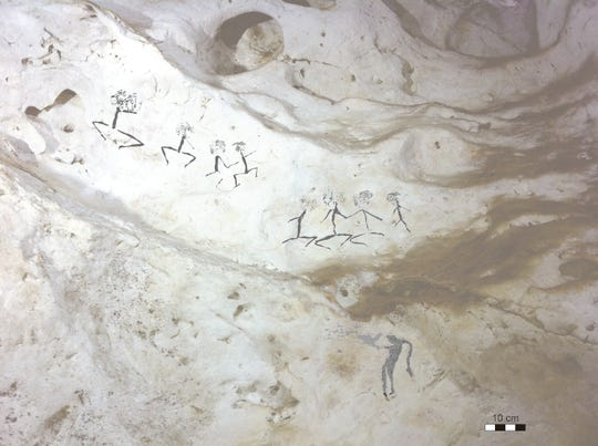 Paintings of human figures were discovered in a cave in East Kalimantan on Borneo, Indonesia. The figures were drawn anywhere from 13,600 to 20,000 years ago.
