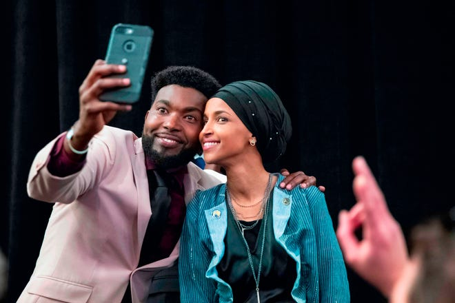 Ilhan Omar, newly elected to the U.S. House of Representatives on the Democratic ticket, celebrates with her supporters after her Congressional 5th District primary victory in Minneapolis, Minnesota on Nov. 6. U.S. voters elected two Muslim women, both Democrats, to Congress this year, marking a historic first in a country where anti-Muslim rhetoric has been on the rise.