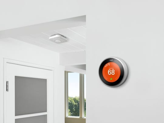 A smart thermostat, like the Nest Learning Thermostat pictured here, learns what temperature you like and automatically programs itself.