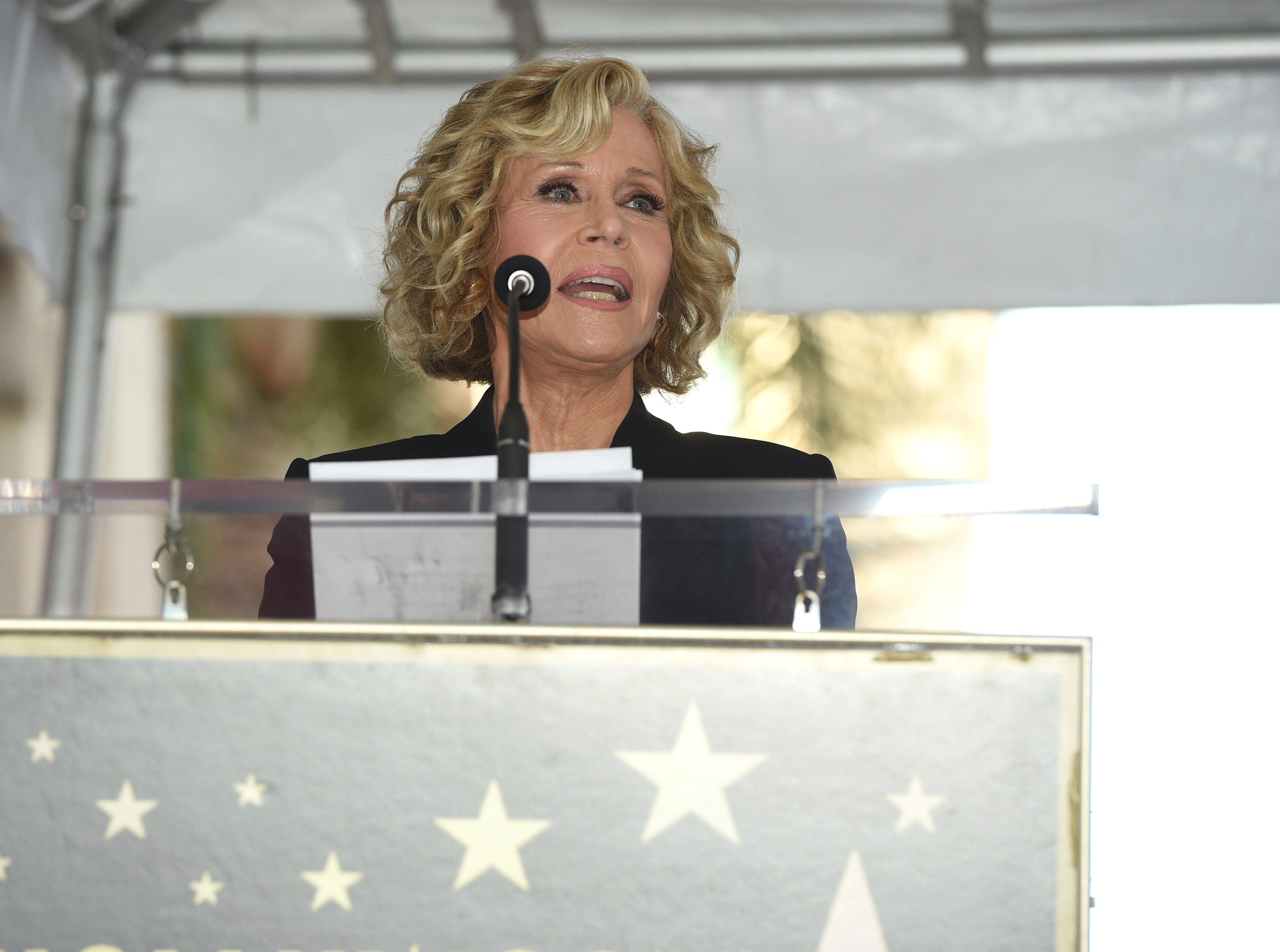 """Actress Jane Fonda, a co-star in the film """"The China Syndrome,"""" speaks during a ceremony honoring actor Michael Douglas with a star on the Hollywood Walk of Fame on Tuesday, Nov. 6, 2018, in Los Angeles. (Photo by Chris Pizzello/Invision/AP) ORG XMIT: CAPM107"""