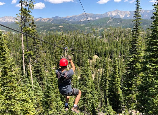 A thrilling zip line tour down Lone Mountain at the Big Sky Resort.