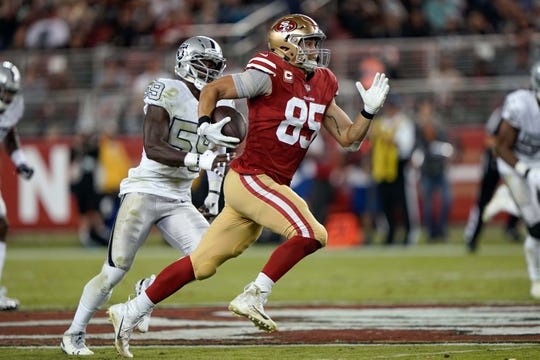 San Francisco 49ers tight end George Kittle caught four passes for 108 yards and a touchdown Thursday against the Oakland Raiders.