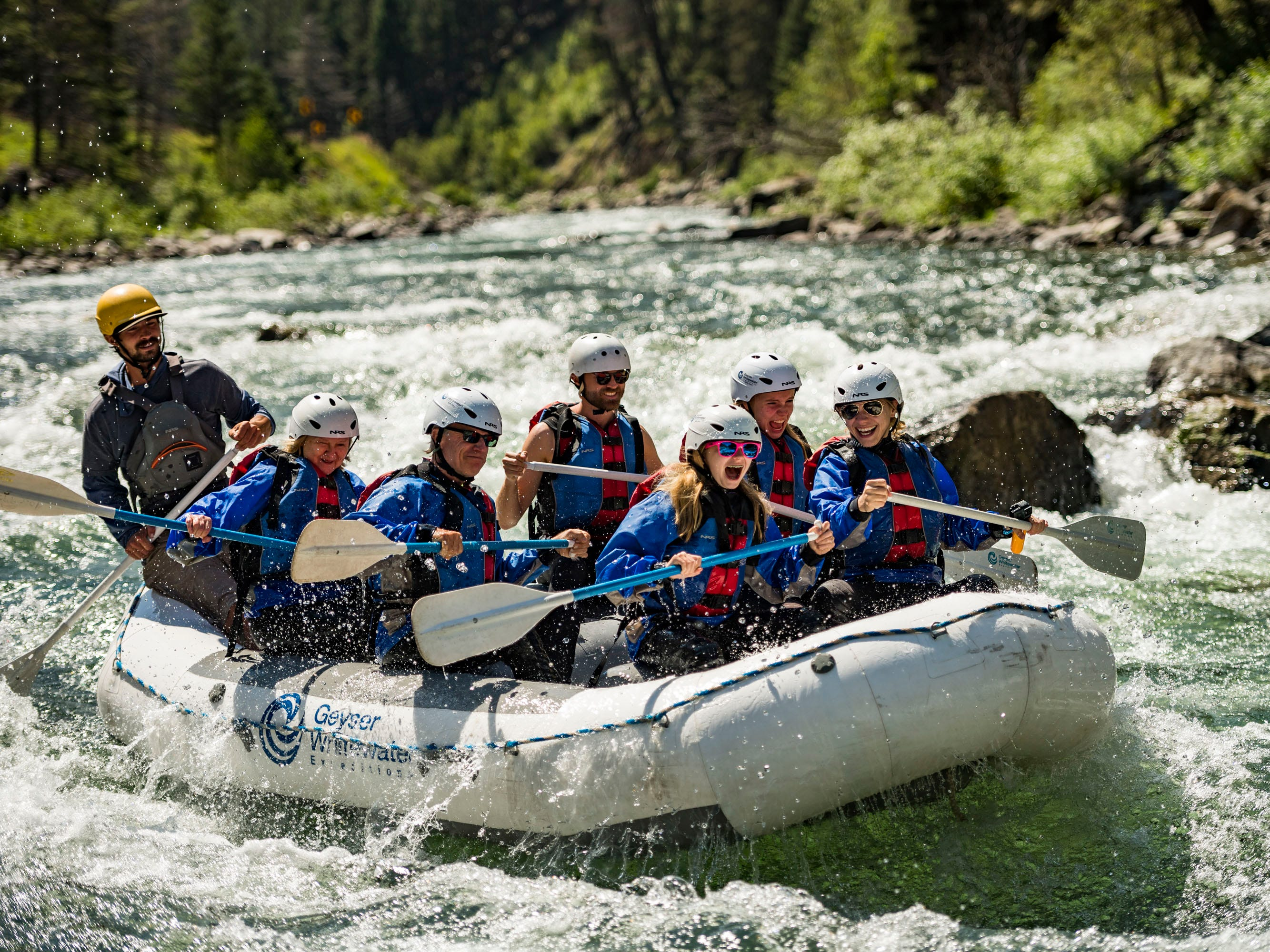 Navigating the rapids of the Gallatin during a whitewater rafting expedition.