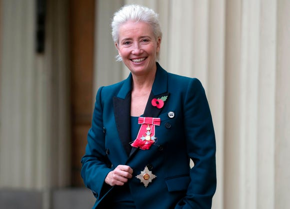 English actor Emma Thompson poses with her medal and insignia after she was appointed a Dame Commander of the Order of the British Empire (DBE) at an investiture ceremony at Buckingham Palace in London on November 7, 2018. (Photo by Steve Parsons / POOL / AFP)STEVE PARSONS/AFP/Getty Images ORIG FILE ID: AFP_1AN3DZ