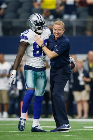 Dallas Cowboys wide receiver Dez Bryant (88) is greeted by head coach Jason Garrett before the game against the Los Angeles Rams at AT&T Stadium.