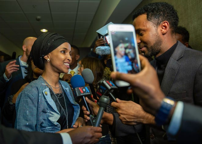 Ilhan Omar, left, newly elected to the U.S. House of Representatives on the Democratic ticket, speaks to the media in Minneapolis on Tuesday, Nov. 6.