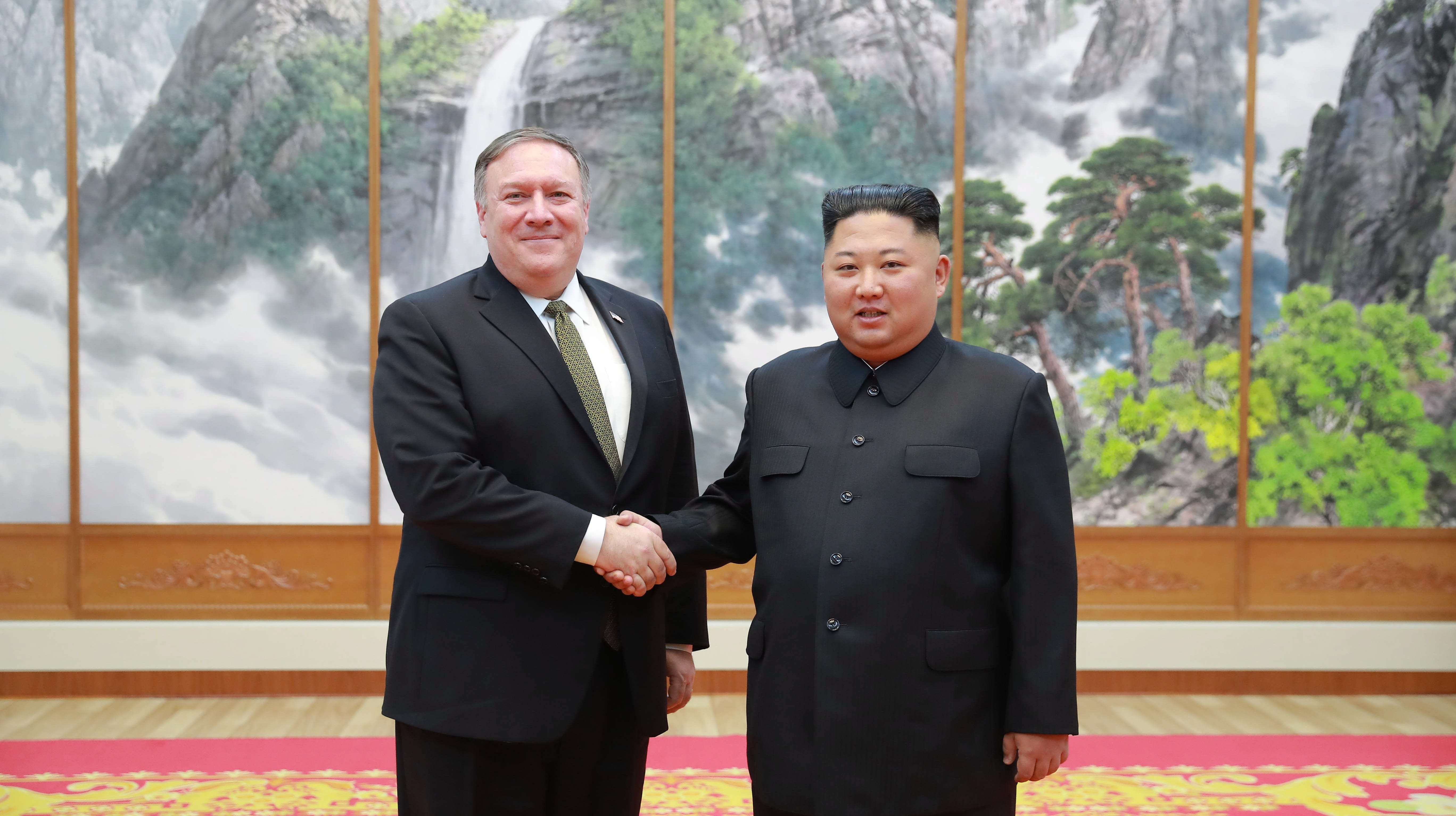 A photo released by the official North Korean Central News Agency (KCNA), the state news agency of North Korea, shows North Korean leader Kim Jong-un (R) shaking hands with United States Secretary of State Mike Pompeo (L) during their meeting in Pyongyang, North Korea, Oct. 7 October 2018.