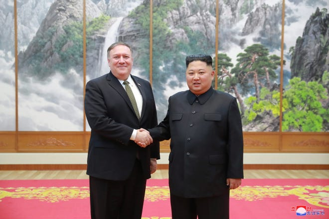 A photo released by the official North Korean Central News Agency (KCNA), the state news agency of North Korea, shows North Korean leader Kim Jong Un shaking hands with U.S. Secretary of State Mike Pompeo during their meeting in Pyongyang on Oct. 7, 2018.