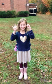 Moorestown, New Jersey second grader Sofia Rubich, 7, celebrates her 40th consecutive day wearing the same outfit to school as part of the One Outfit, 100 Days project.