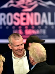 Montana's GOP Senate candidate, Matt Rosendale, talks with supporters Nov. 6, 2018, at the Delta Hotel in Helena, Mont., as he and his supporters wait for the election results.