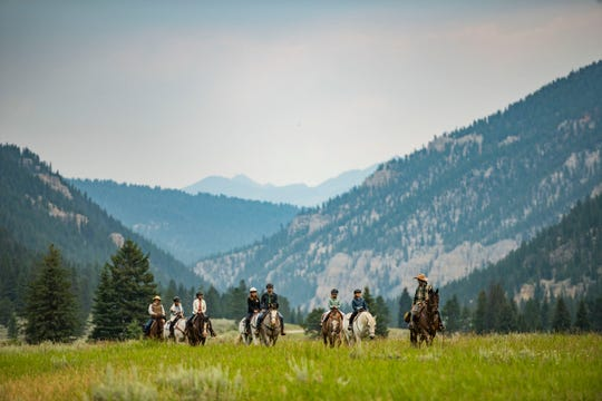 Wranglers at the 320 Guest Ranch host a two-hour group horseback ride through mountain meadows.