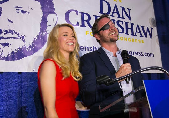 """FILE - In this Tuesday, May 22, 2018, file photo, Republican congressional candidate Dan Crenshaw reacts to the crowd with his wife, Tara, as he comes on stage to deliver a victory speech during an election night party at the Cadillac Bar, in Houston. Crenshaw has chided """"Saturday Night Live"""" comic Pete Davidson for poking fun of the eyepatch he wears because he was badly wounded during his third tour in Afghanistan as a Navy SEAL. (Mark Mulligan/Houston Chronicle via AP, File) ORG XMIT: TXHOU702"""
