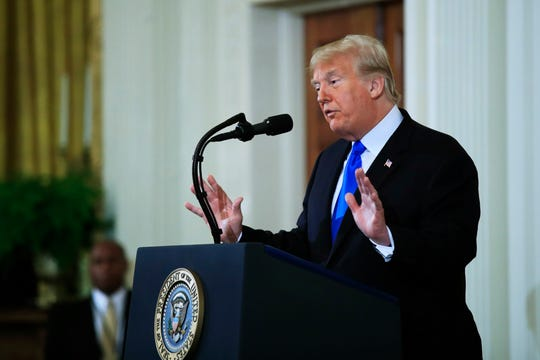 President Donald Trump speaks during a news conference in the East Room at the White House on Wednesday.