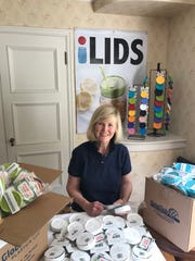 iLids founder Traci Tenneson poses with her invention.