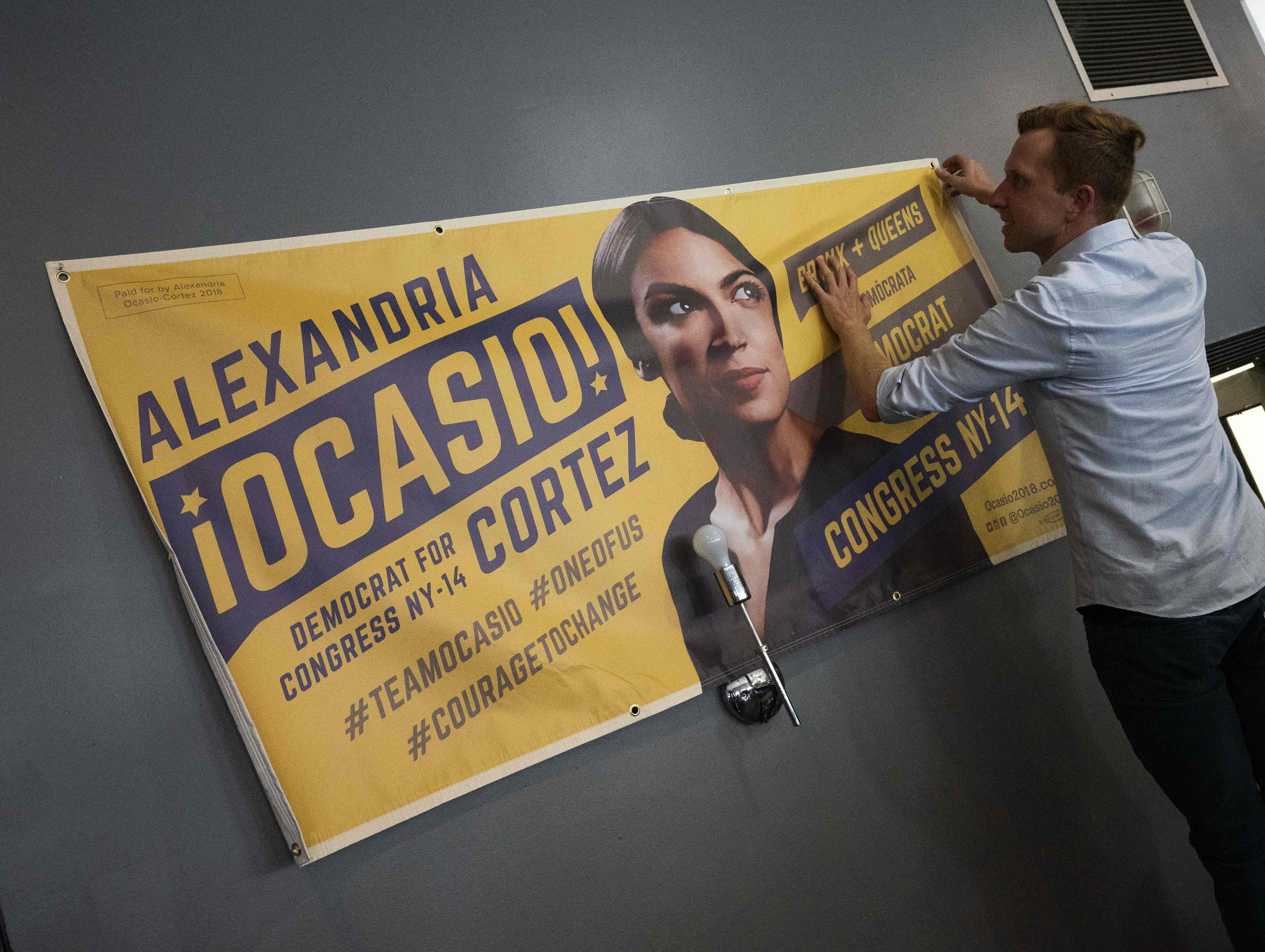 Campaign workers prepare for the arrival of democratic congressional candidate Alexandria Ocasio-Cortez for her general campaign kick-off rally on Sept. 22, 2018 in the Bronx borough of New York.