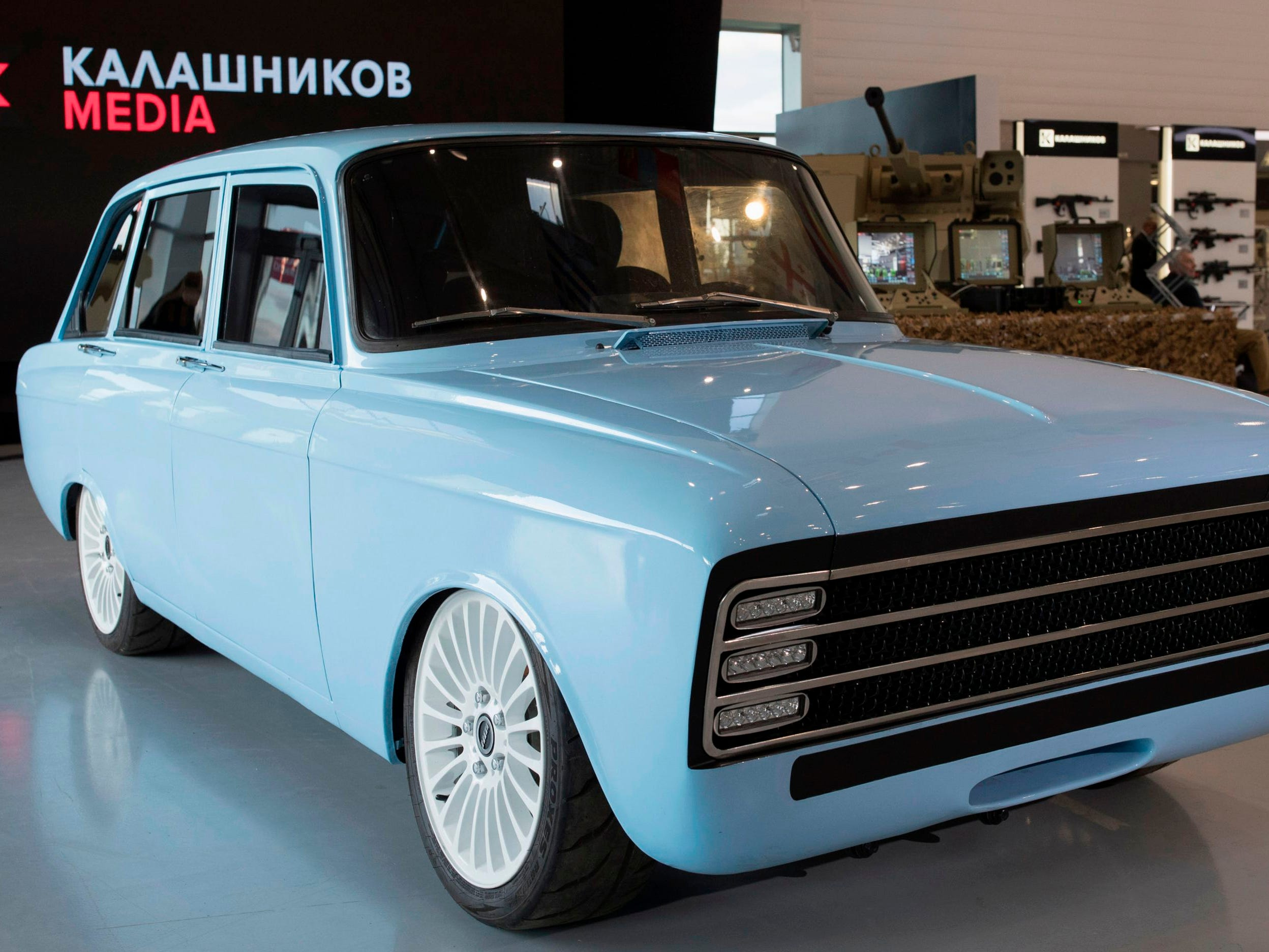A retro-looking pale blue prototype electric car, the CV-1,  produced by Russian arms maker Kalashnikov, in Moscow on Aug. 22, 2018.
