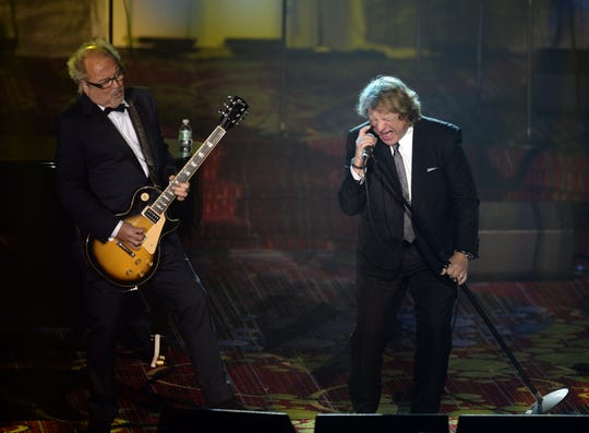 Lou Gramm and Mick Jones put their differences aside to perform together at the Songwriters Hall of Fame induction ceremony in New York in 2013.