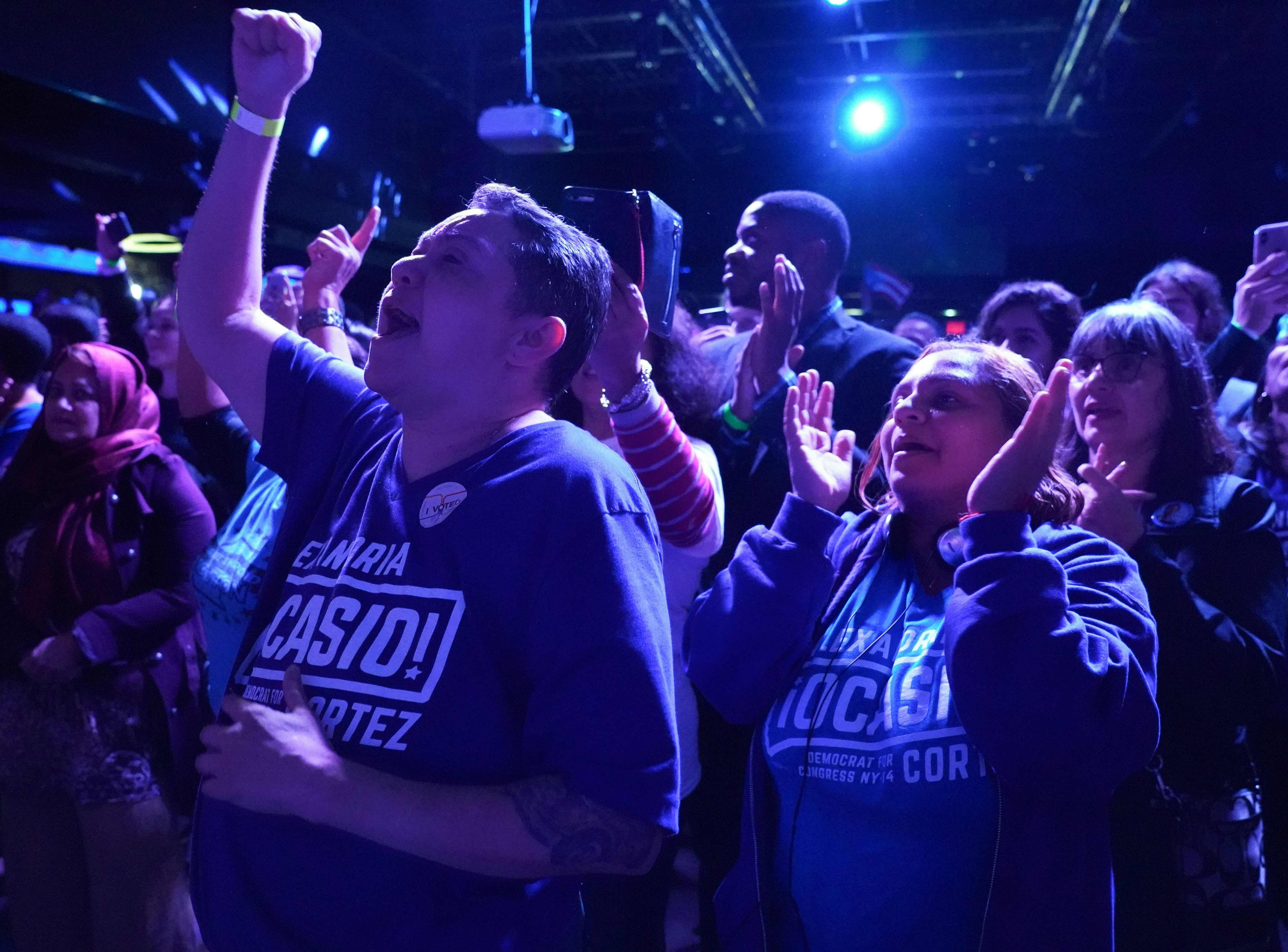 Supporters of Alexandria Ocasio-Cortez cheer while she speaks onstage during her election night party in the Queens Borough of New York on Nov. 6, 2018.