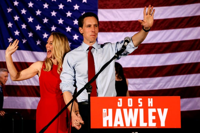 Sen.-elect Josh Hawley walks on stage with his wife Erin to make his victory speech during an election watch party Tuesday night in Springfield, Mo.