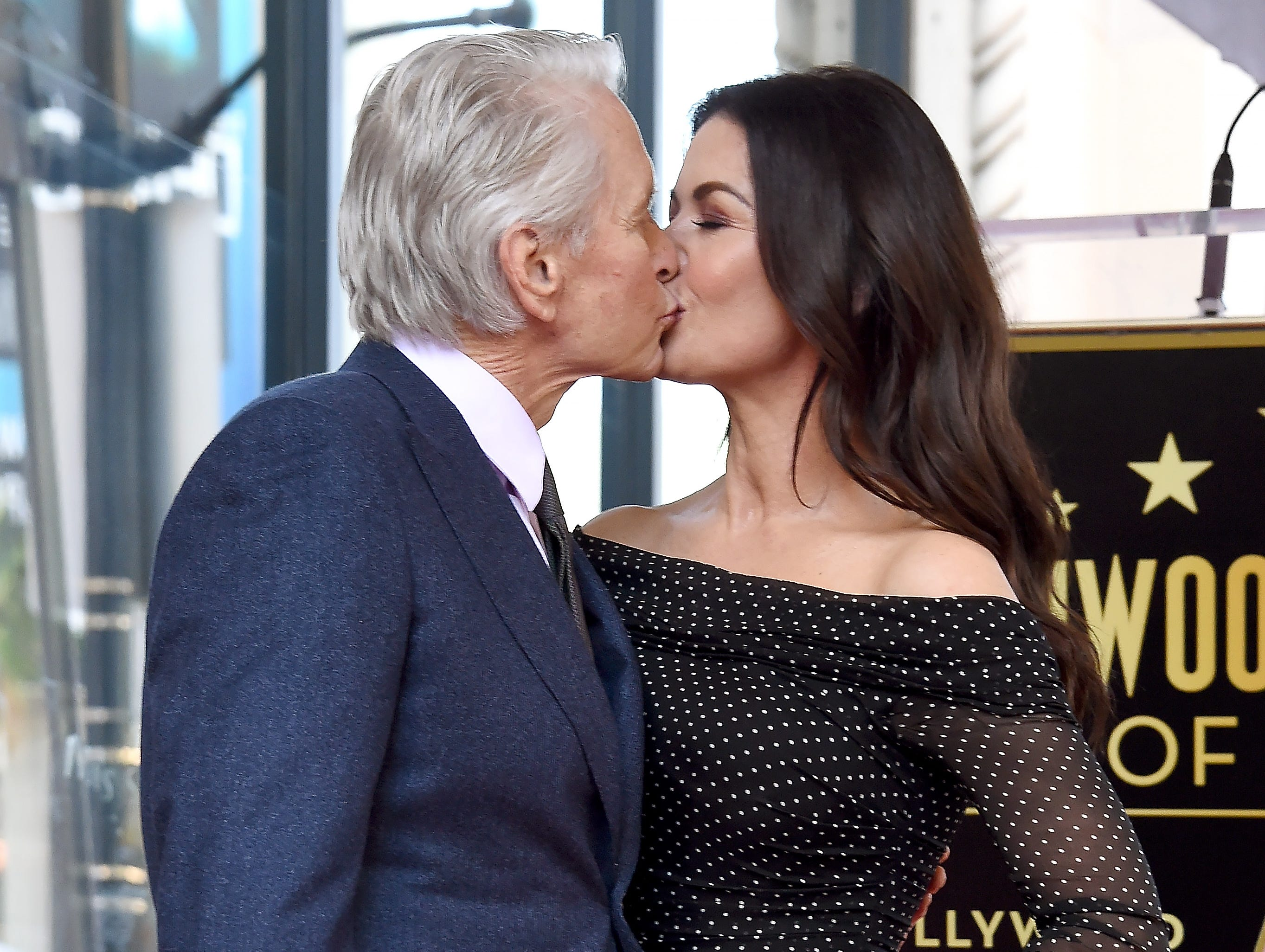 HOLLYWOOD, CA - NOVEMBER 06:  Michael Douglas and Catherine Zeta-Jones pose at the Michael Douglas Star On The Hollywood Walk Of Fame ceremony on November 6, 2018 in Hollywood, California.  (Photo by Gregg DeGuire/Getty Images) ORG XMIT: 775248764 ORIG FILE ID: 1058324098