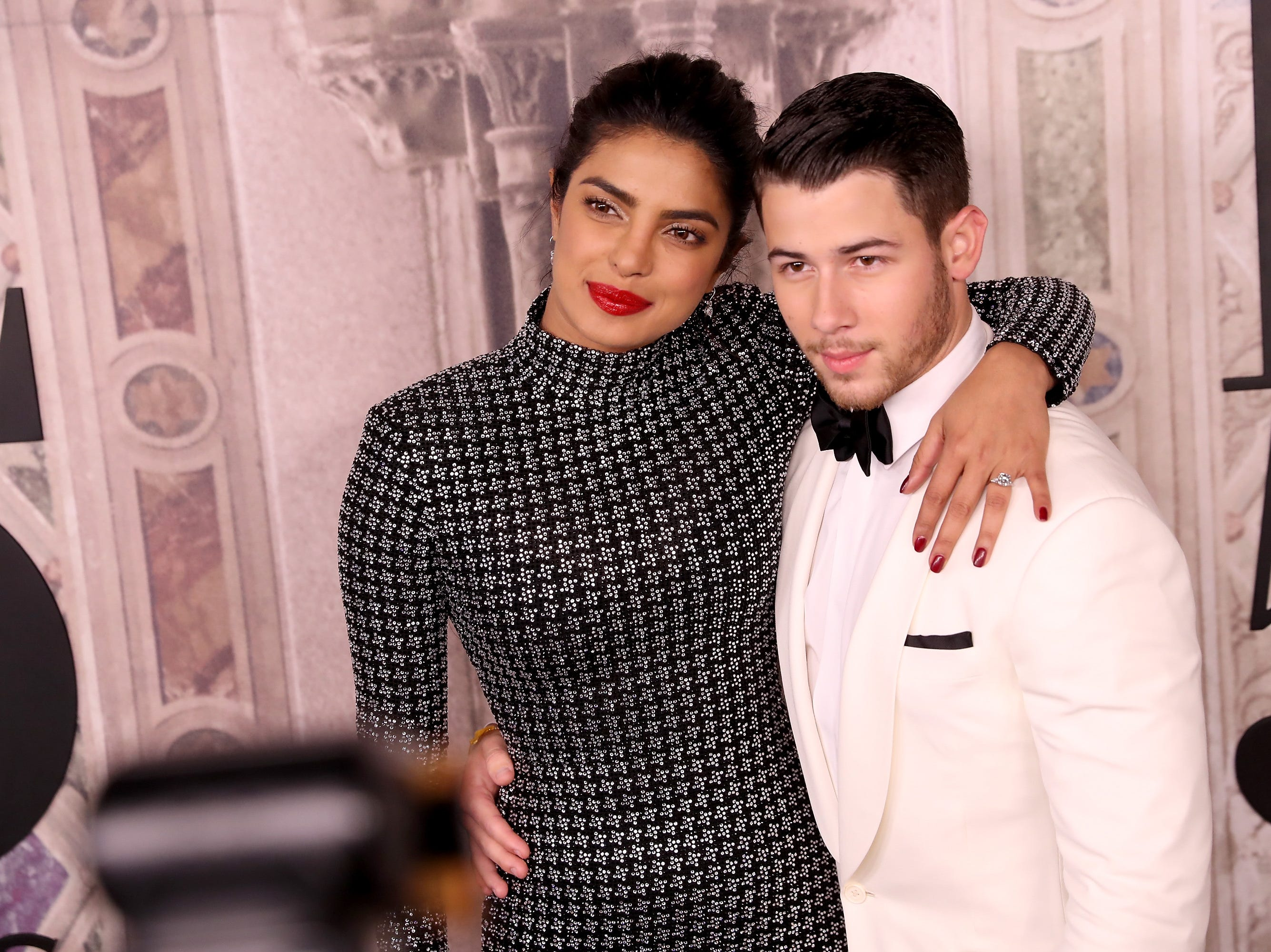 Priyanka Chopra and Nick Jonas attend the Ralph Lauren fashion show during New York Fashion Week in September.