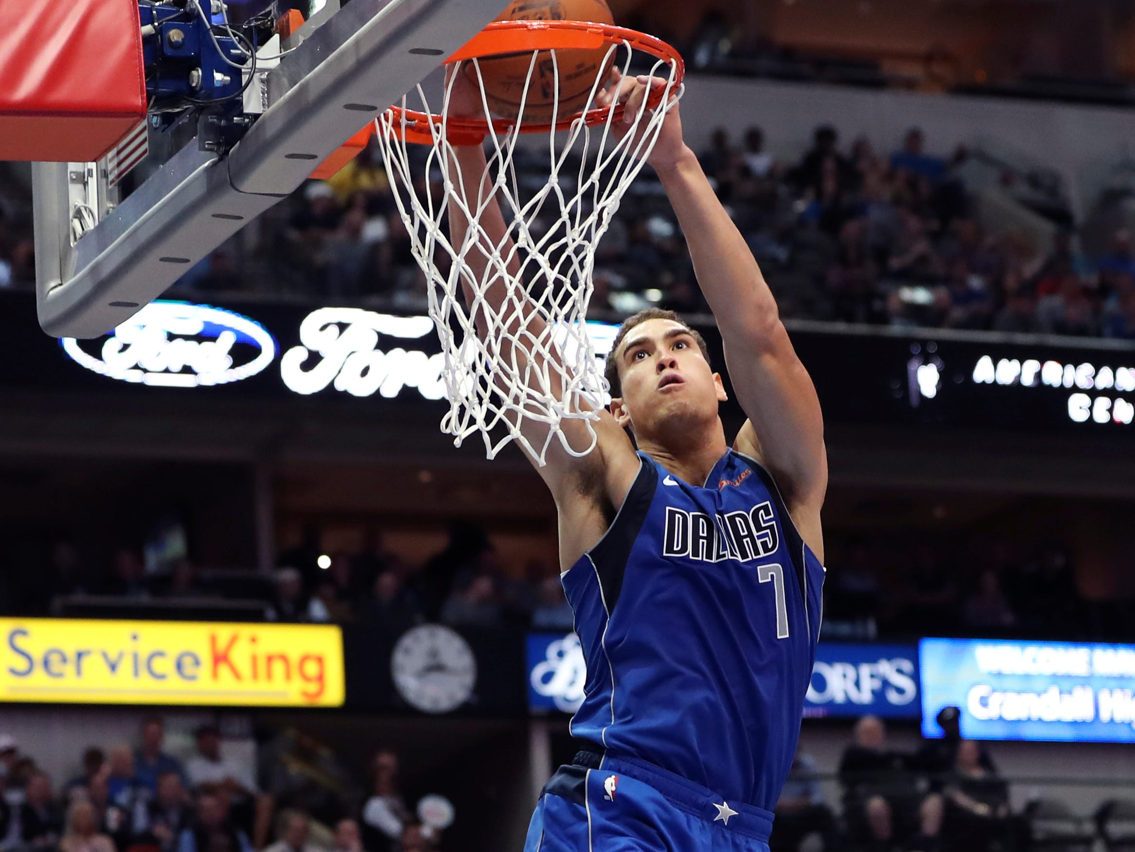 Nov. 6: Mavericks forward Dwight Powell slams it down with two hands during the first half against the Wizards in Dallas.