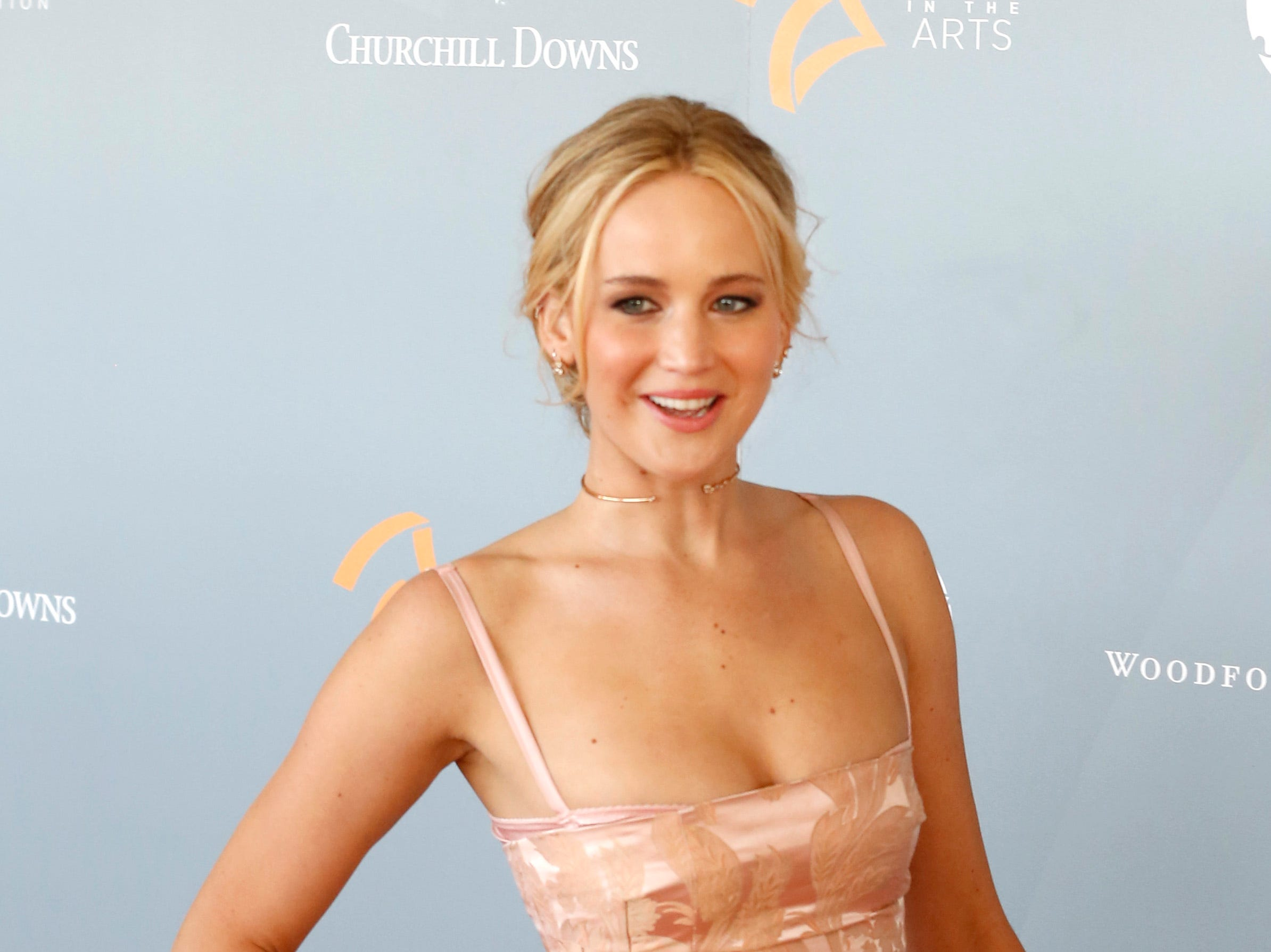 Apr 27, 2018; Louisville, KY, USA; Jennifer Lawrence walks the 'orange carpet' at the 3rd annual Awards in the Arts Ceremony at Churchill Downs in Louisville, Kentucky. Mandatory Credit: Scott Utterback/Courier Journal via USA TODAY NETWORK ORIG FILE ID:  20180429_jel_usa_644.jpg