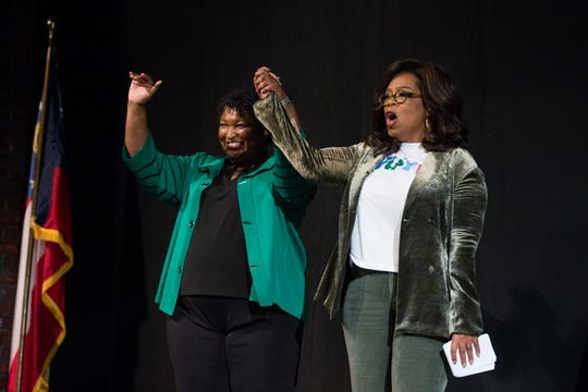 Oprah Winfrey and Georgia Democratic gubernatorial candidate Stacey Abrams during a town hall event at the Cobb Civic Center on Nov. 1, 2018 in Marietta, Georgia.