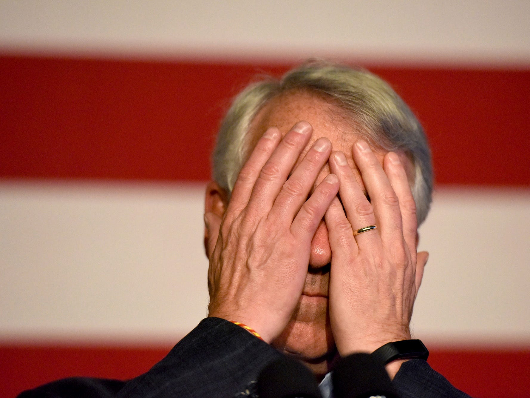 Bob Hugin, the Republican candidate in the New Jersey Senate race, covers his eyes while giving a concession speech to his supporters at the Stage House Tavern in Mountainside, N.J., Tuesday, Nov. 6, 2018.