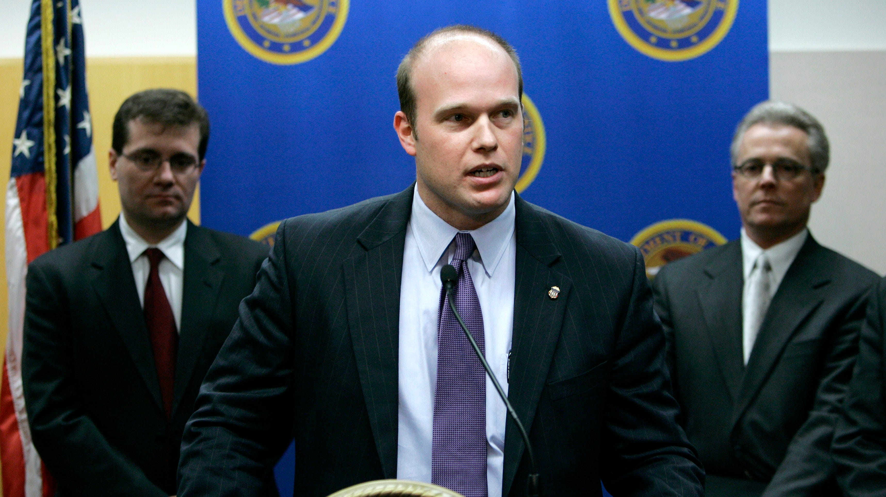 U.S. Attorney Matthew Whitaker speaks during a news conference as James Vandenberg, Office of Inspector General for the Dept. of Labor, left, and Iowa state Auditor David Vaudt, right, look on Jan. 16, 2007, in Des Moines, Iowa. President Donald Trump named Whitaker acting attorney general Wednesday, after Jeff Sessions resigned.