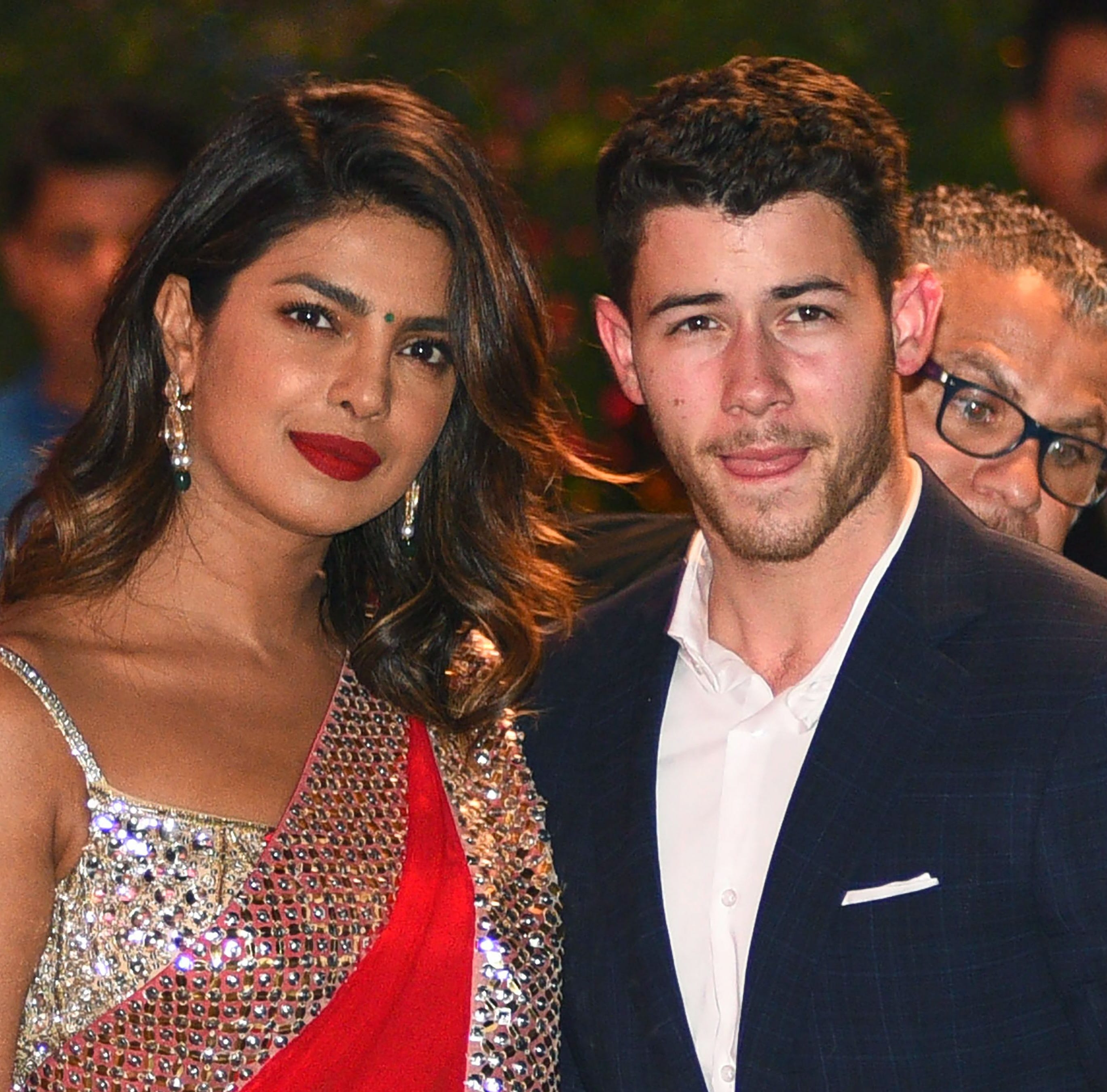 "(FILES) In this file photo taken on June 28, 2018, Indian Bollywood actress Priyanka Chopra (L) accompanied by Nick Jonas arrive for the pre-engagement party of India's richest man and Reliance Industries Limited Chairman, Mukesh Ambanis eldest son Akash Ambani and fiancee Shloka Mehta in Mumbai. - American singer Nick Jonas on August 18 announced Indian superstar Priyanka Chopra will be ""Mrs Jonas"" after the couple performed a traditional ceremony in Mumbai, the home of Bollywood cinema. (Photo by SUJIT JAISWAL / AFP)SUJIT JAISWAL/AFP/Getty Images ORIG FILE ID: AFP_18G0BC"