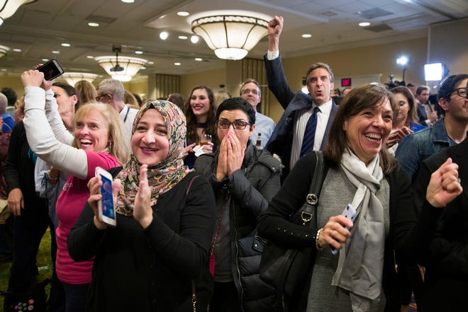 Supporters cheer as they watch returns at an election night party for Democrat congressional candidate Jennifer Wexton on Nov. 6, 2018, in Dulles, Virginia.