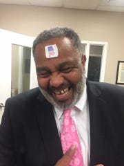 Anthony Ray Hinton proudly wore his voting sticker on his forehead Tuesday. The former death row inmate was wrongfully convicted and released in 2015. It was his first time voting in a midterm election.