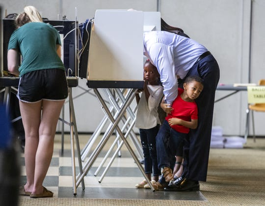 Democratic gubernatorial candidate Andrew Gillum casts his ballot with his 4-year-old twins Caroline, left, and Jackson on Election Day on Nov. 6, 2018, in Tallahassee, Fla. Gillum is facing off in a close race against Republican candidate Ron DeSantis.