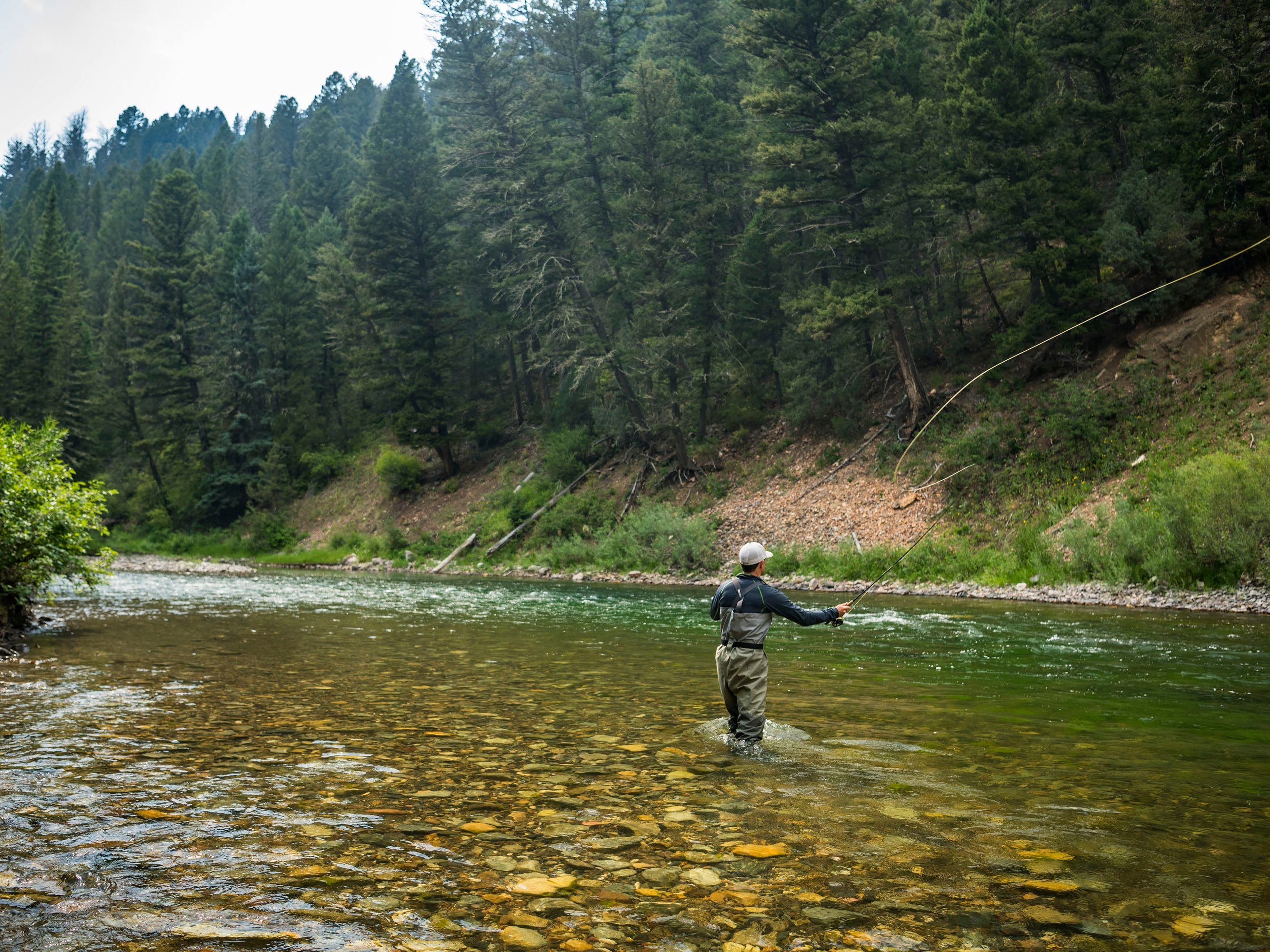 Activities in Montana include fly-fishing on the Gallatin River, a contemplative – and, it turns out, delightful – way to chill out.