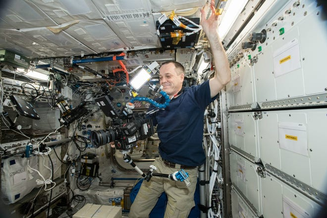 NASA astronaut Ricky Arnold uses the new 8K camera aboard the International Space Station.