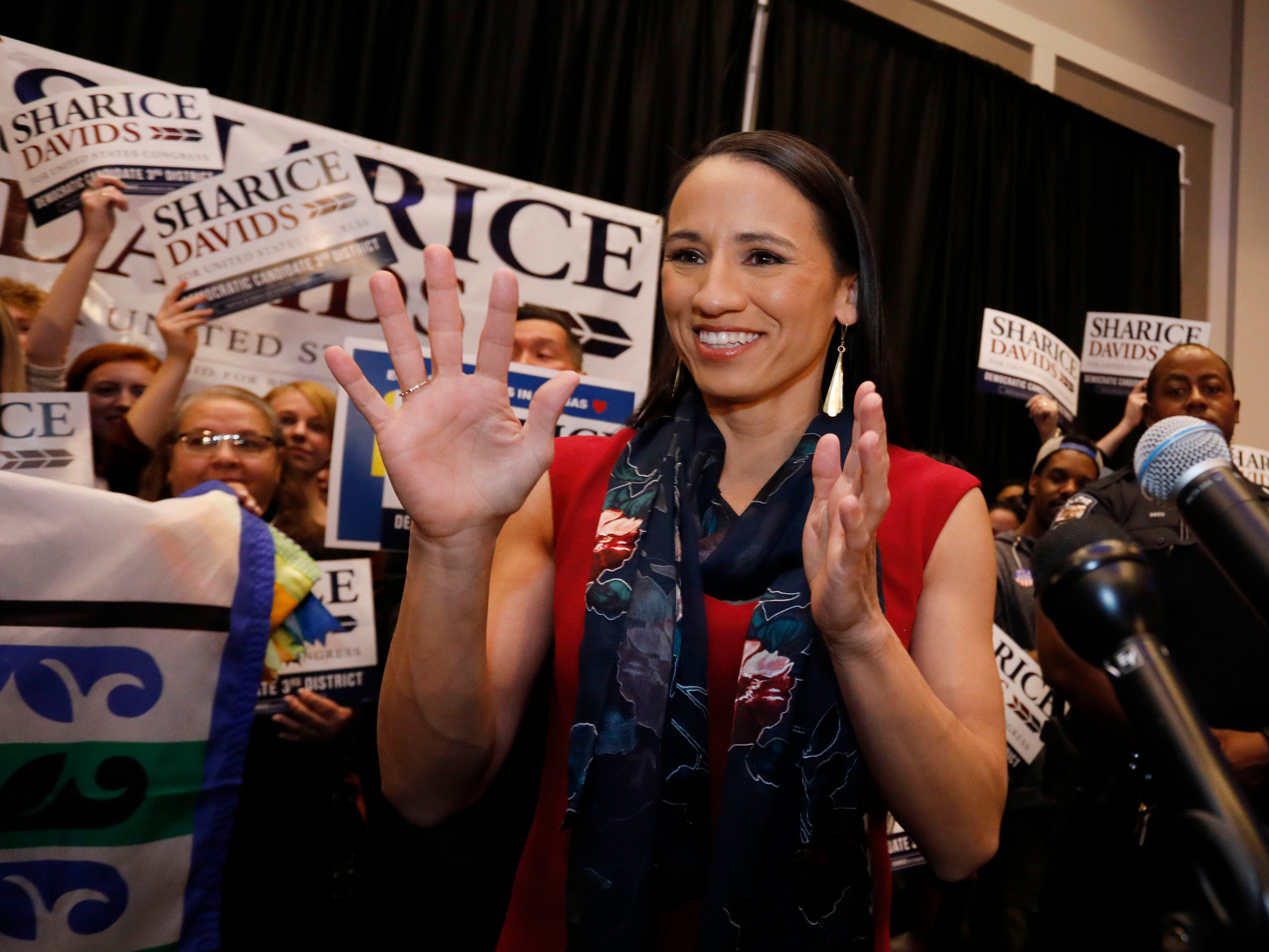 Democrat house candidate Sharice Davids reacts before speaking to supporters at a victory party in Olathe, Kan., Tuesday, Nov. 6, 2018. Davids defeated Republican incumbent Kevin Yoder to win the Kansas' 3rd Congressional District seat.