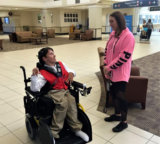 Victoria Hubbard of Winnfield chats with Andrew from the Louisiana Special Education Center at Alexandria International Airport Thursday. Andrew is participating in the Airport Ambassadors program.