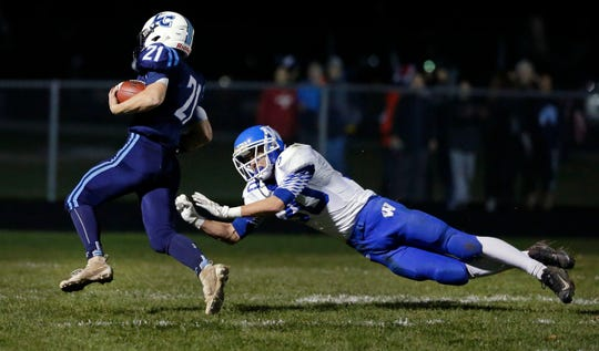 Isaac Van Deurzen of Little Chute runs for a touchdown against Wrightstown during a state quarterfinal victory.