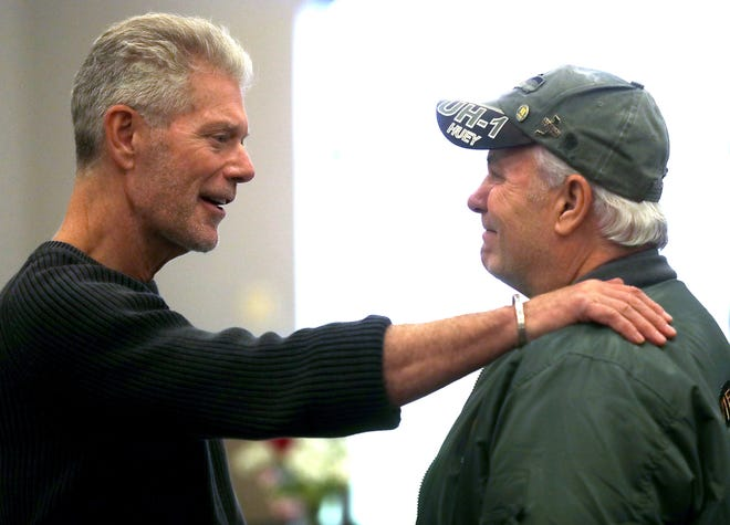 Actor Stephen Lang, left, speaks with U.S. Army veteran Bruce Leavitt, who served in Vietnam, during the  Honoring Veterans Luncheon on Thursday at Fox Valley Technical College in Grand Chute.