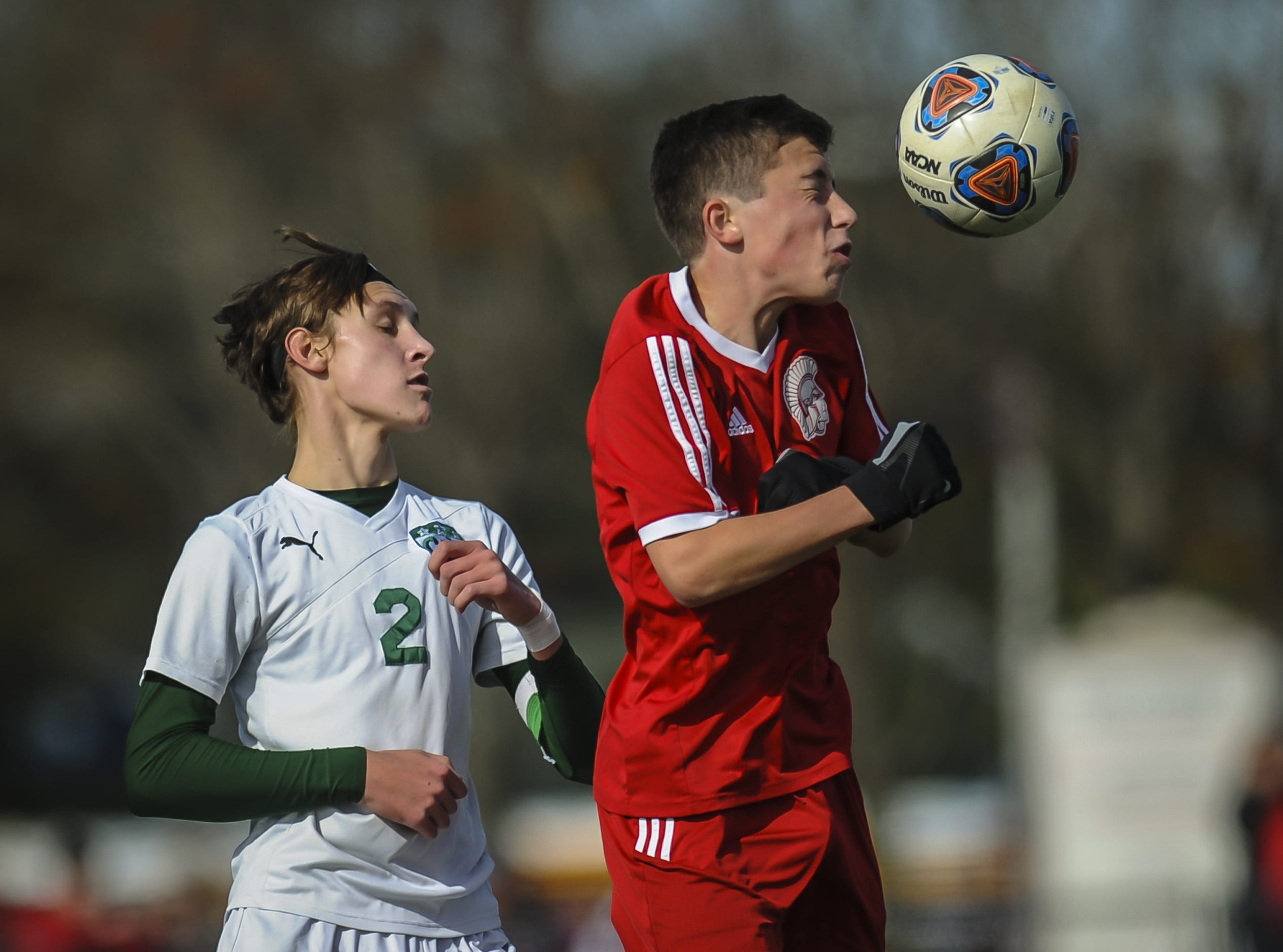 Robert Lopes of Ocean Twp., (right) heads the ball in front of Brooks Condon of Colts neck in the NJSIAA Central Jersey, Group III final on Nov. 8, 2018 in Ocean.