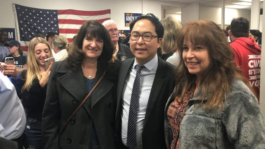Andy Kim surrounded by supporters at his campaign office Wednesday night in Mount Laurel after he declared victory over Tom MacArthur.