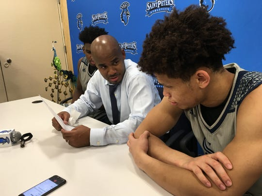 Shaheen Holloway with Davauhnte Turner  during Saint Peter's postgame press conference
