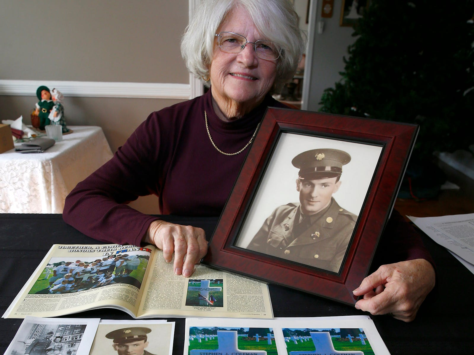 Carol Donahue holds a photo of her father, Stephen J. Coleman, amongst other memorabilia in her Colts Neck home Thursday, November 8, 2018.  He was killed in the D-Day invasion.