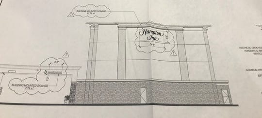 A drawing depicts a new Hampton Inn planned for the site of the Pine Rest Motel in Toms River
