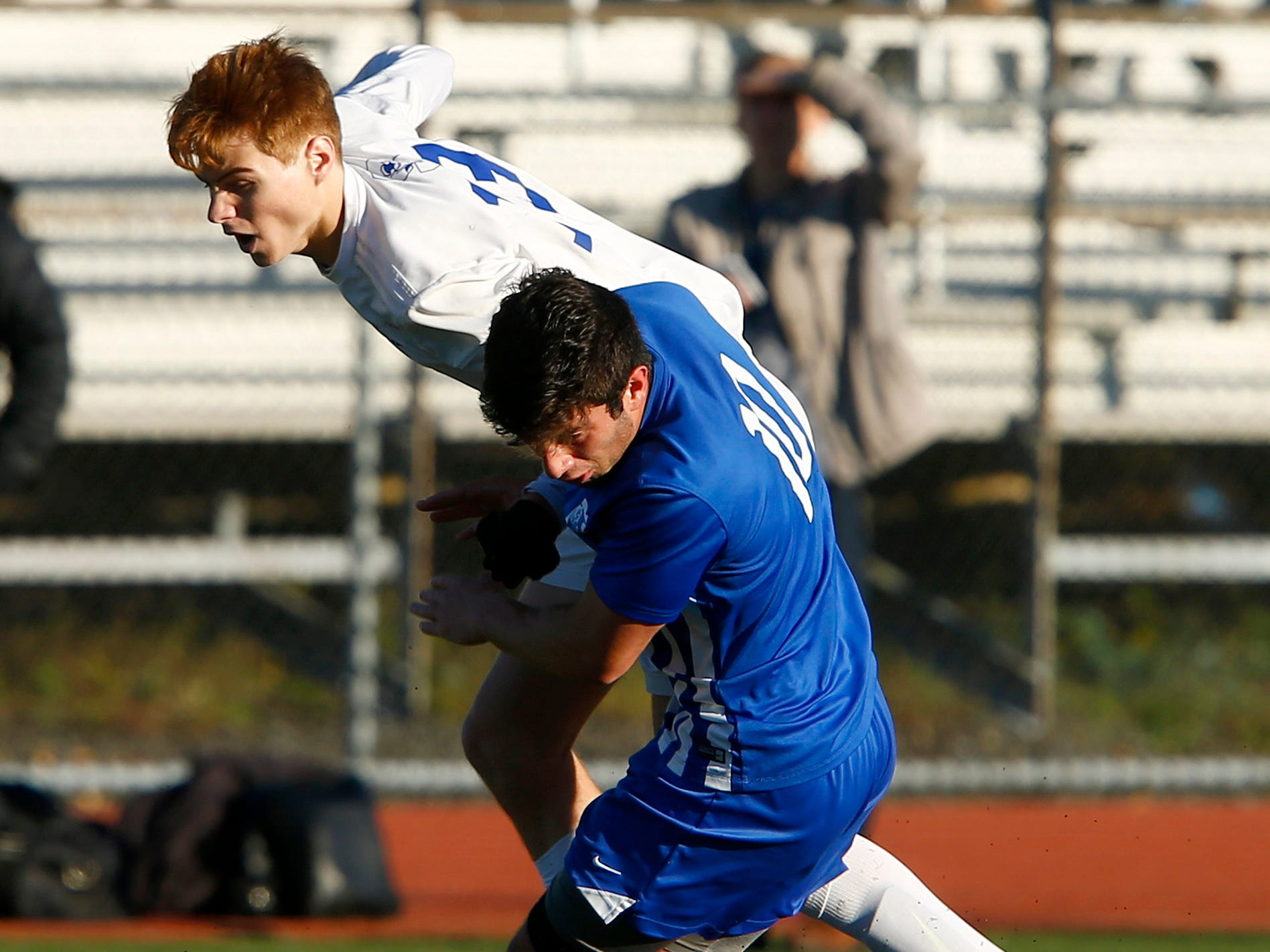 Holmdel's Anthony Arena (#10) battles with Shore Regional's Ryan Bongarzone for control of the ball during their Central Group II boys soccer final game played in Holmdel Thursday, November 8, 2018.
