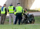 RAW VIDEO: A motorcycle left Route 33 westbound and landed on Route 33 Business eastbound below.