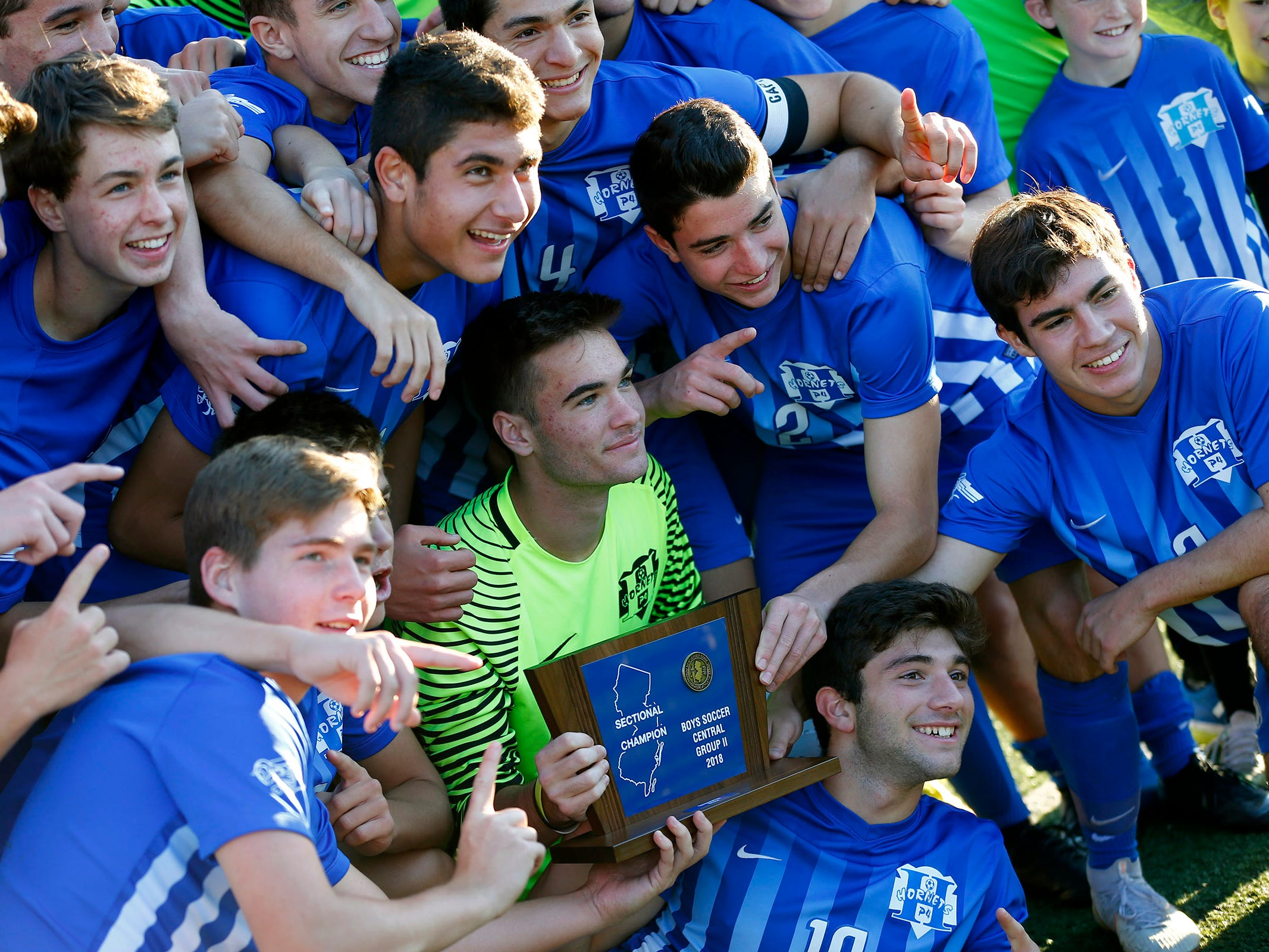 Holmdel players hold their Central Group II boys soccer final trophy after defeating 14th-seeded Shore Regional 4-0 in a game played in Holmdel Thursday, November 8, 2018.